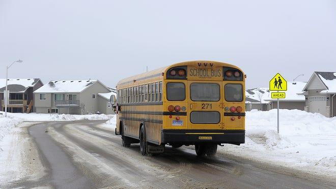 A Sioux Falls school bus drops students off in the Westwood Valley neighborhood that is located in the Tea Area School District on Wednesday in Sioux Falls. A Supreme Court decision could make it more difficult for parents to move school districts.