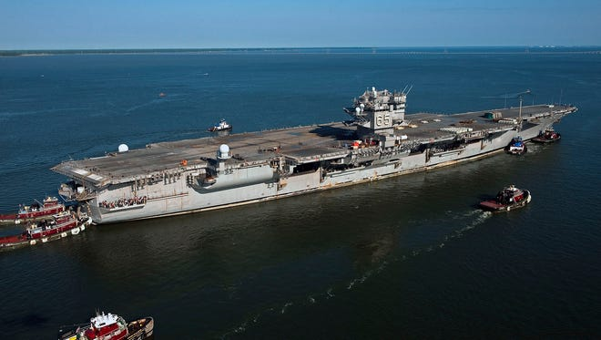 The aircraft carrier USS Enterprise makes its final voyage to Newport News Shipbuilding in Virginia in June 2013.
