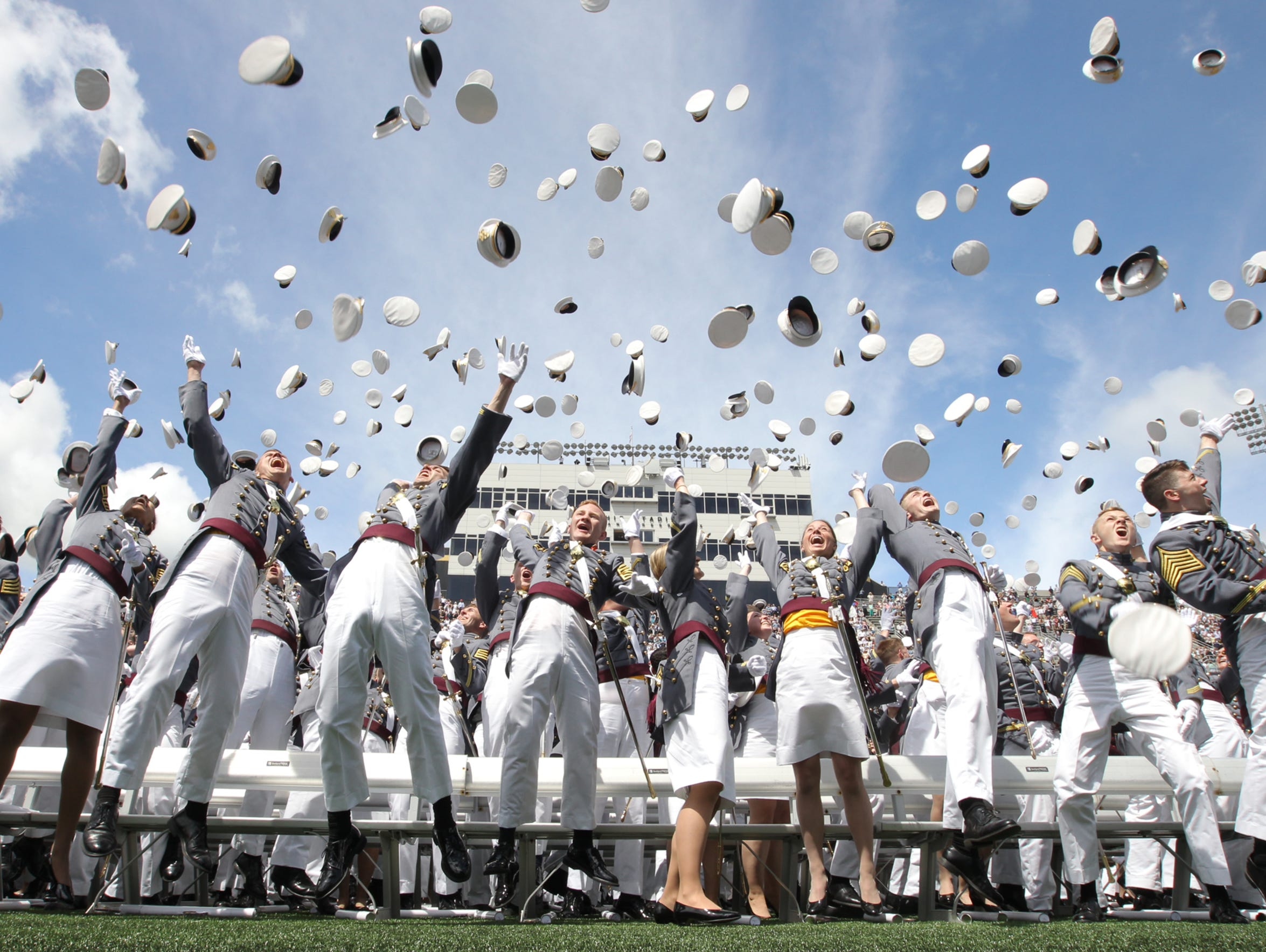 West Point cadets throw their covers at the close of