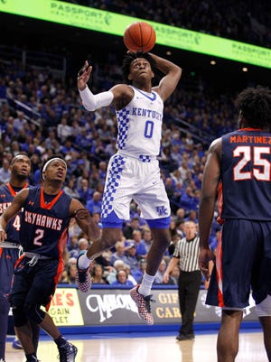 Nov 25, 2016; Lexington, KY, USA; Kentucky Wildcats guard De'Aaron Fox (0) goes up for a dunk against Tennessee-Martin Skyhawks guard Jacolby Mobley (2) in the first half at Rupp Arena.