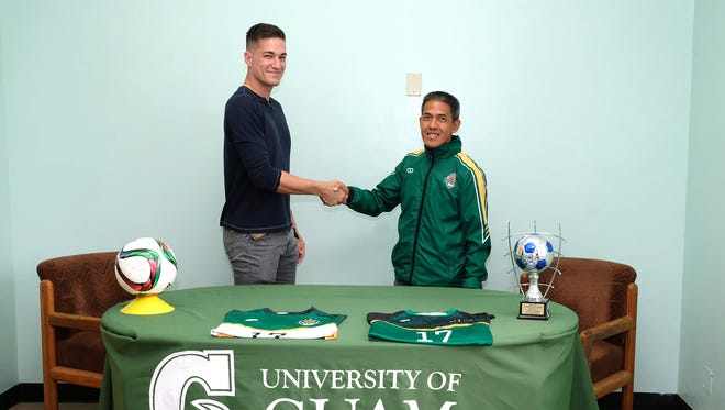 Kyle Legozzie shakes UOG men's soccer coach Rod Hidalgo's hand after signing a Athletic Letter of Intent with the Tritons Aug. 18, 2017.