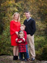 Kristy Brown, her husband, Andy, and two kids Evan