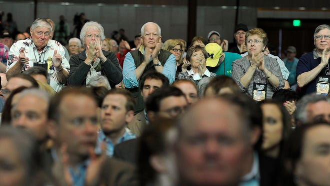 The audience applauds while Louisiana Gov. Bobby Jindal speaks during the NRA convention at Music City Center in Nashville on April 10, 2015.