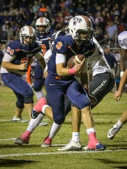 Blackman QB Connor Mitchell looks for running room
