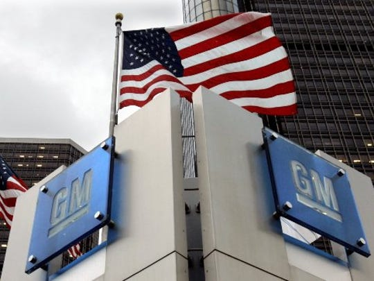 The General Motors logo is seen outside the GM headquarters in downtown Detroit.