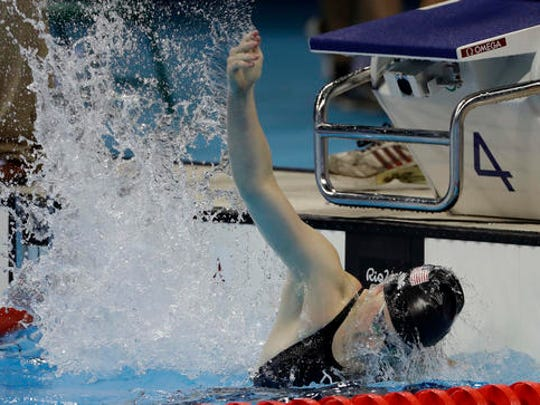 Lilly King of the United States celebrates winning the gold medal in the women's 100-meter breaststroke at the 2016 Summer Olympics, Monday, Aug. 8, 2016, in Rio de Janeiro, Brazil.