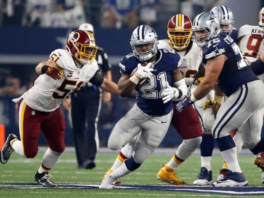 Dallas Cowboys running back Ezekiel Elliott (21) runs