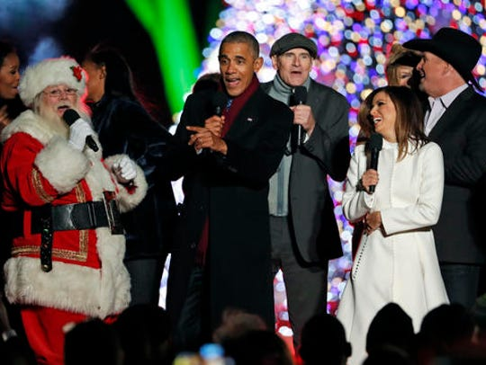 "President Barack Obama, sings ""Jingle Bells,"" with"