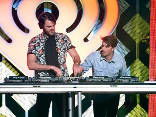 FILE - This Dec. 9, 2016 file photo shows Alex Pall, left, and Andrew Taggart from The Chainsmokers, performing at Z100's iHeartRadio Jingle Ball in New York.
