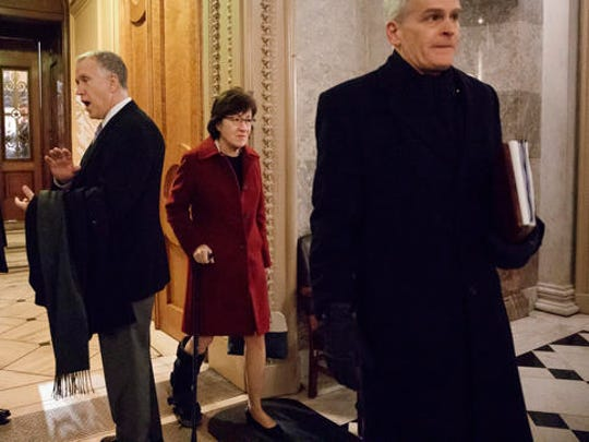 Sen. Susan Collins, R-Maine, center, flanked by Sen. Thom Tillis, R-N.C., left, and Sen. Bill Cassidy, R-La., right, depart the Senate chamber on Capitol Hill in Washington, Friday, Feb. 3, 2017. Collins and Sen. Lisa Murkowski, R-Alaska defected from the GOP majority and voted against Education Secretary-designate DeVos.