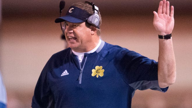 Knoxville Catholic's head coach Steve Matthews yells on the sidelines during a high school football game at Maryville High School against Knoxville Catholic High School Friday, Aug. 18, 2017.