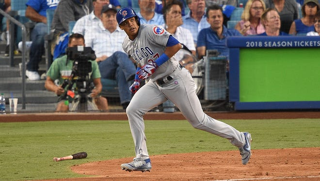 Chicago Cubs shortstop Addison Russell runs the bases after hitting a solo home run in the fifth inning against the Los Angeles Dodgers during game two of the National League Championship Series at Dodger Stadium on October 15 in Los Angeles.