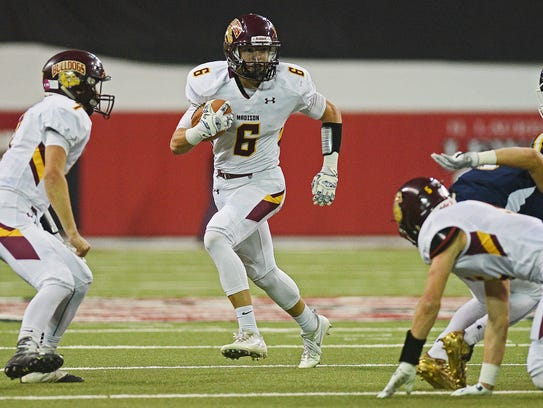 Madison's Jaxon Janke (6) carries the ball in for a