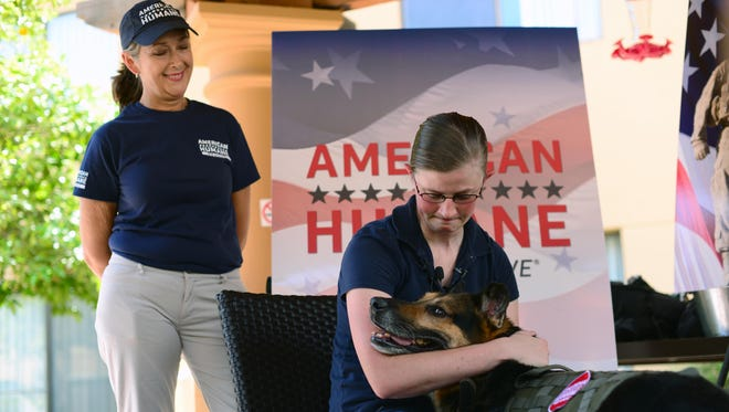 Staff Sgt. Amanda Cubbage, a 355th Security Forces Squadron member, reunites with her recently retired military working dog, Rick, in Tucson, Ariz., Aug. 8, 2017. Cubbage worked with Rick while she served as a MWD handler at Osan Air Base, South Korea.