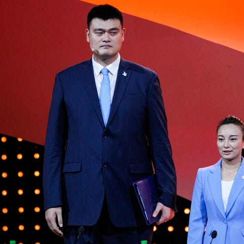 Retired Chinese professional basketball player Yao Ming (L) and two time Olympic champion in short track, Yang Yang (R) during the Presentations by the Candidate Cities for the Third Winter Youth Olympic Games in 2020, at the Convention Centre in Kuala Lumpur, Malaysia, on July 31, 2015.