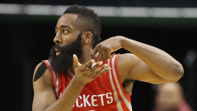 Rockets guard James Harden does his stirring-the-pot celebration.