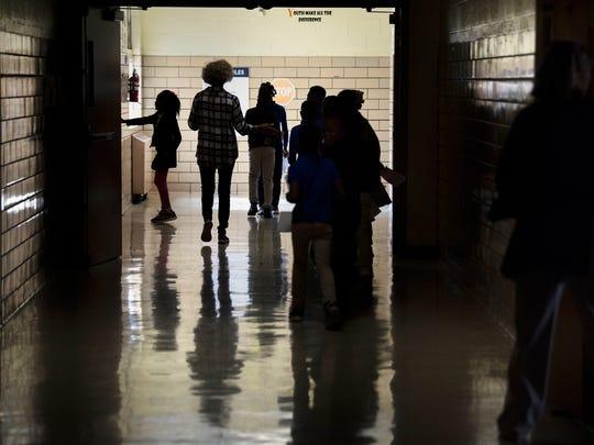 Alexander Elementary School students walk between classes