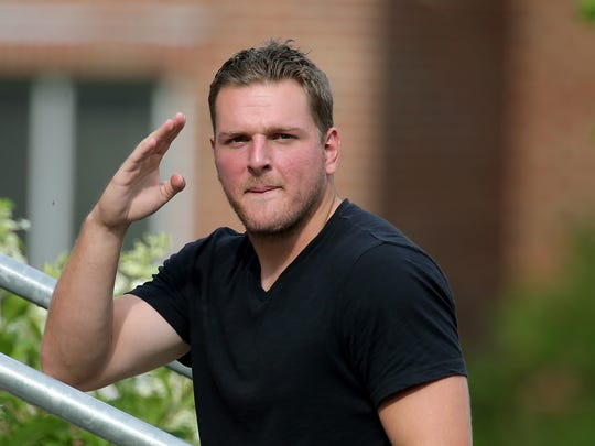 Indianapolis Colts punter Pat McAfee salutes to the media after he arrived on the first day of training camp, on Wednesday, July 23, 2014, at Anderson University.