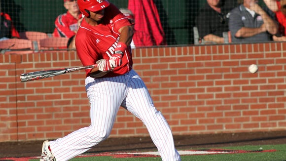 UL's Greg Davis hits a solo home run in the second inning against UL Monroe this past Friday to continue his torrid hitting streak.