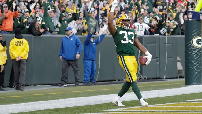Green Bay Packers running back Aaron Jones celebrates his game-winning touchdown run during overtime against the Tampa Bay Buccaneers on Dec. 3, 2017, at Lambeau Field.