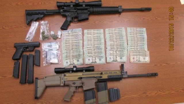 Weapons, cash and drugs were seized by Waynesboro police following raids Wednesday night and Thursday morning.