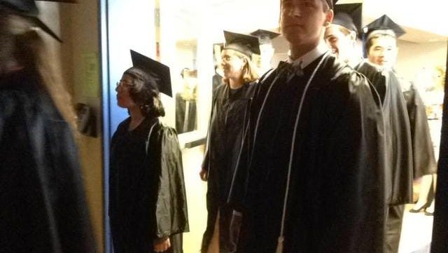 Ave Maria University students enter the Golisano Field House for the school's 10th Commencement.