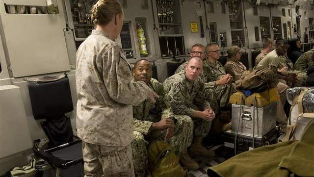 Seabees with Naval Mobile Construction Battalion 133 are briefed Sept. 19 aboard a C-17 in Djibouti on their imminent mission in Liberia, where they will build a hospital in support of efforts to contain the Ebola epidemic.