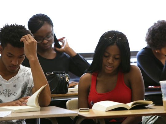 """Senior Ashley Joseph reads a passage from """"The New"""