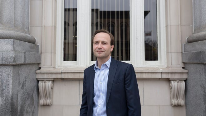 Gubernatorial candidate and Lt. Governor Brian Calley, poses for a portrait outside of a bank he worked at in Ionia on Monday, April 16, 2018.
