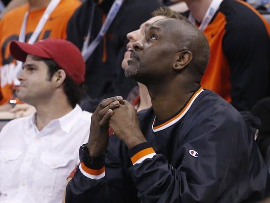Former NBA player Gary Payton looks up at the scoreboard in the second half of a first-round men's college basketball game between VCU and Oregon State in the NCAA Tournament, Friday, March 18, 2016, in Oklahoma City. VCU won 75-67. His son Gary Payton II plays for Oregon State. (AP Photo/Sue Ogrocki)