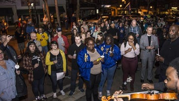 Joshua Coyne, Music Director of the College of Saint Elizabeth plays in a Multi-college campus Peace March in Madison, February 23, 2017.