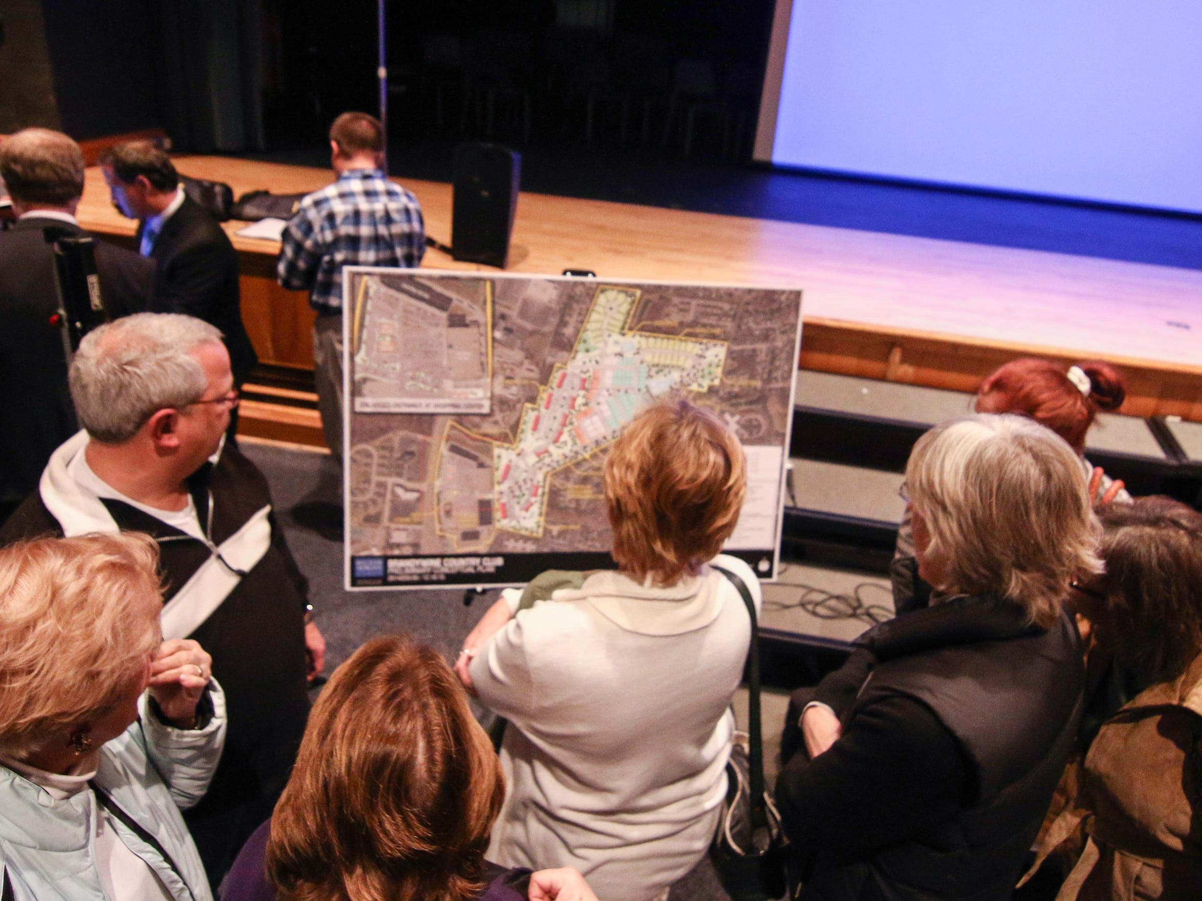 Residents review preliminary conceptual plans for the development of Brandywine Country Club during a public meeting Dec. 10 at Brandywine High School in Wilmington.