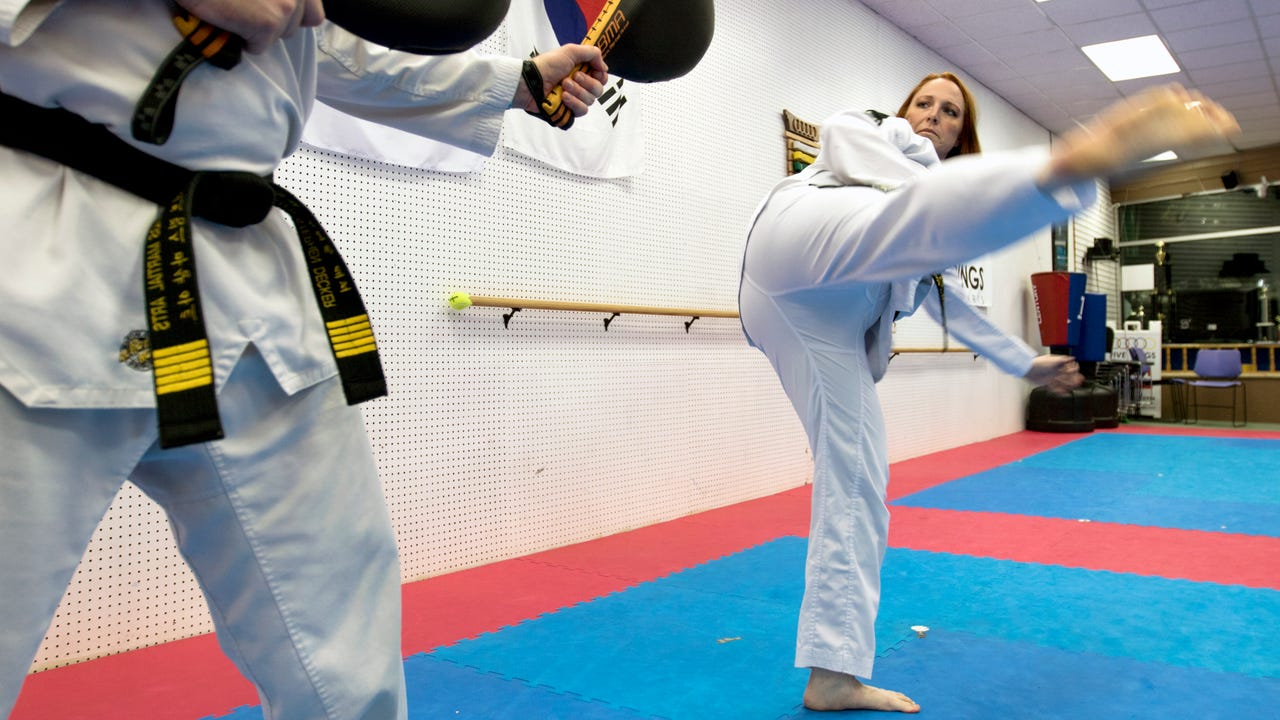 Alyssa Fencil of Stevens Point, Wis. trains at the Five Rings Martial Arts studio in Stevens Point on September 19, 2017. Fencil has multiple sclerosis and has qualified for the Para Taekwondo World Championships in London this month.