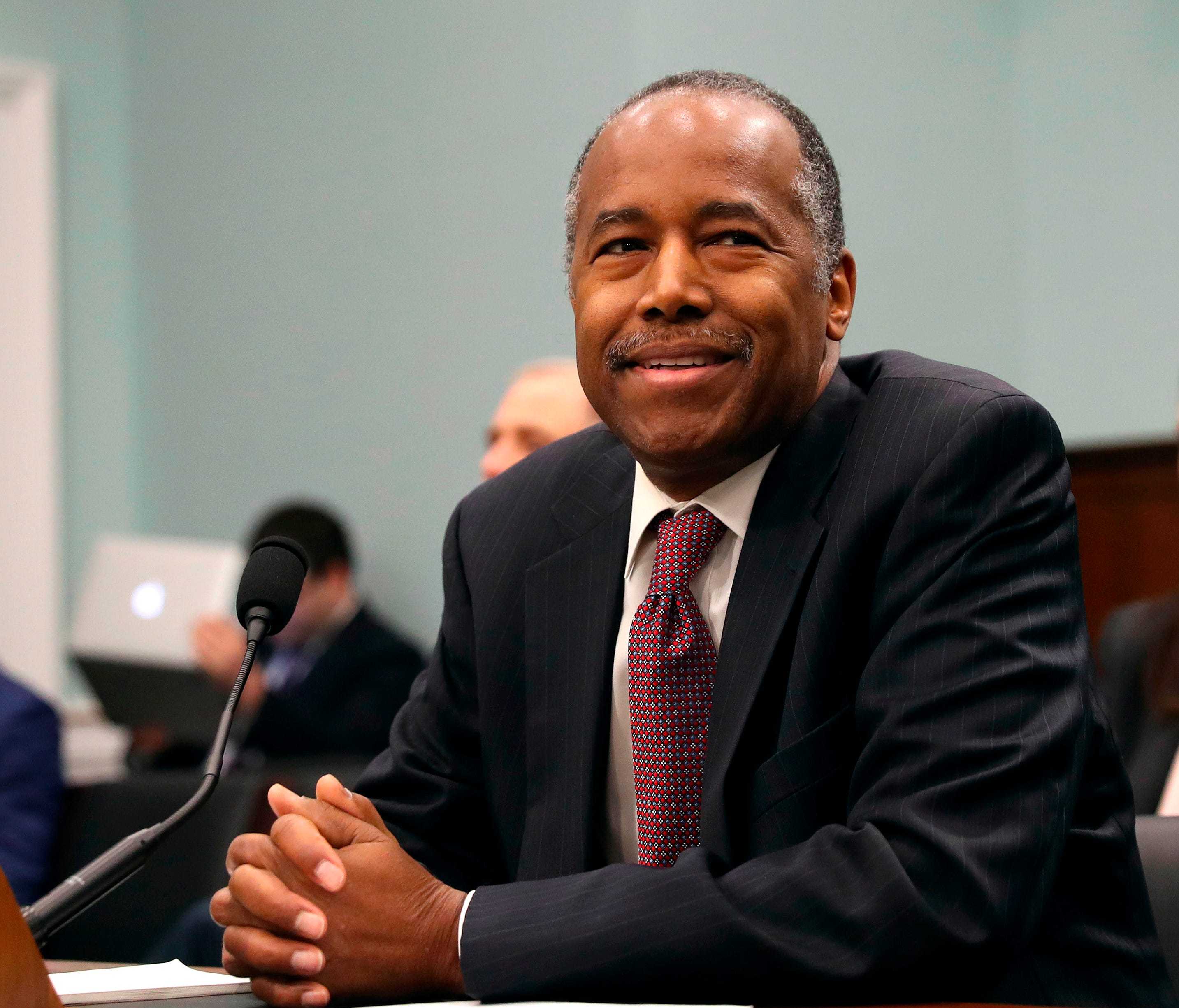 Housing and Urban Development Secretary Ben Carson takes his seat before testifying before a House Committee on Appropriation subcommittee hearing on Capitol Hill in Washington, March 20, 2018.