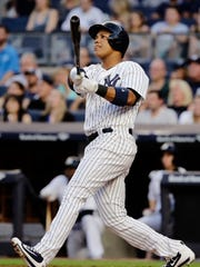 New York Yankees' Starlin Castro hits a three-run home run during the second inning during the second inning of a baseball game against the Baltimore Orioles, Saturday, June 10, 2017, in New York.