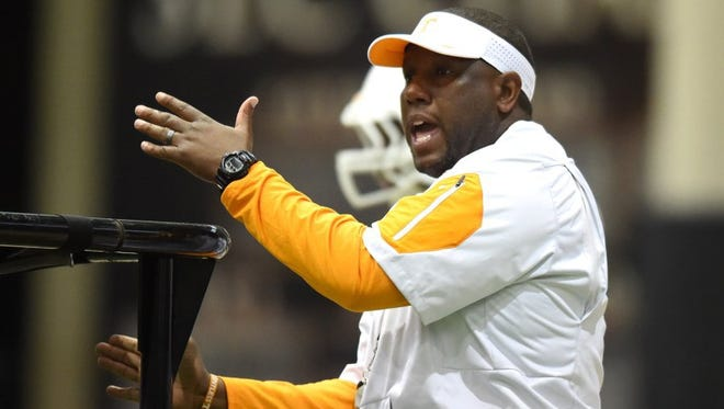 Tennessee tight ends coach Larry Scott gives instruction during spring practice at the Anderson Training Center on March 24.