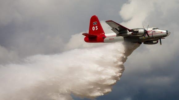 Tanker 05, a Lockheed P-2 Neptune fire tanker, makes