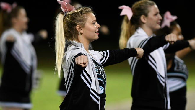 Bayside cheerleaders keep the crowd going during a game at Heritage.