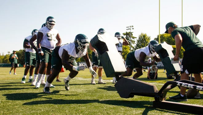 MSU lineman Devyn Salmon, left, works on drills Monday, July 31, 2017, during MSU's first football practice.