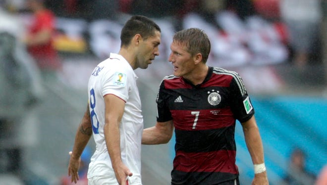 United States' Clint Dempsey argues with Germany's Bastian Schweinsteiger at the half during the group G World Cup soccer match between the United States and Germany at the Arena Pernambuco in Recife, Brazil, Thursday, June 26, 2014. (AP Photo/Julio Cortez)
