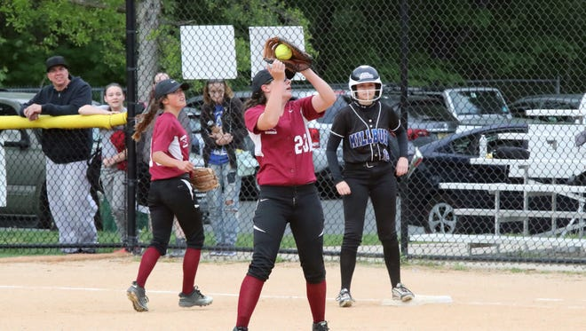 Rachel Jones, hauling in a fly ball this past spring, is expected to be Bloomfield's catcher in 2018.