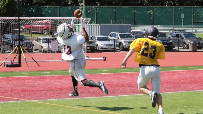 #13 William Robinson hauls in a touchdown pass for Bloomfield during a scrimmage on Aug. 25.