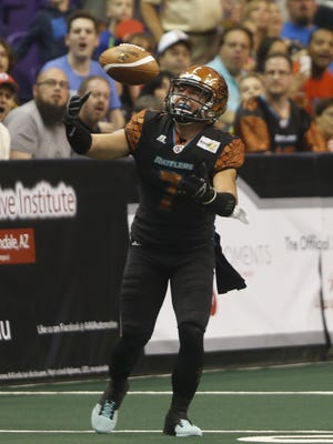 Rattlers' AJ Cruz can't pick off a pass against the Storm at US Airways Center in Phoenix, AZ on June 6, 2015.