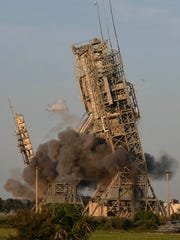 Explosives bring down the  historic launch towers at Launch Complex 17 at Cape Canaveral Air Force Station on July 12, 2018.