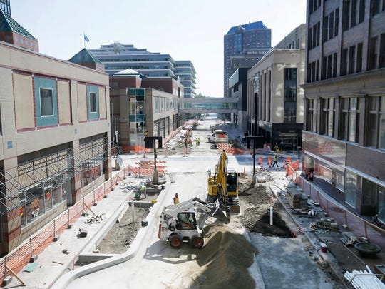 Construction crew members work to rebuild Walnut Street, Monday, June 13, 2016, in downtown Des Moines.