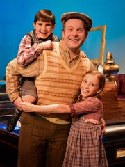 Caractacus Potts (Ryan O'Donnell) with offspring Jeremy (Gracie Payne, left) and Jemima (Evelyn Cantwell).