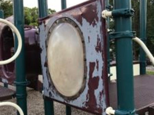Rust is visible on some playground equipment at the