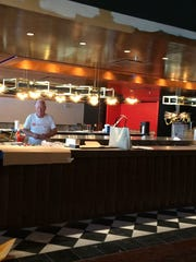 Workers put the finishing touches on the new Joe Muer Seafood restaurant in Bloomfield Hills.