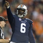 Auburn Tigers quarterback Jeremy Johnson points towards the ROTC section after scoring a touchdown against Idaho on Nov. 21. Johnson was a former U.S. Army All-American selection from G.W. Carver High School.