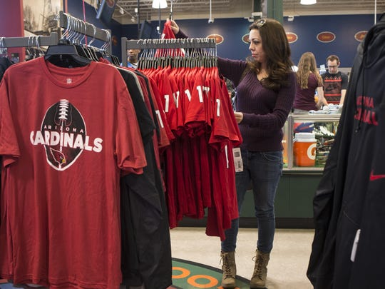 Jasmine Avalos shops for Cardinals merchandise at a
